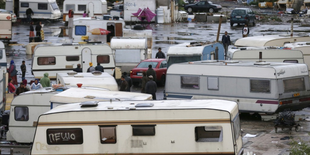 French CRS police stand guard as Roma families are evacuated from their illegal camp in Lille, September 11, 2013. French police evacuated some 30 caravans and their occupants who resided in an illegal camp of around 500 travelling people and Roma in northern France. REUTERS/Pascal Rossignol (FRANCE - Tags: POLITICS SOCIETY IMMIGRATION) - RTX13HAX