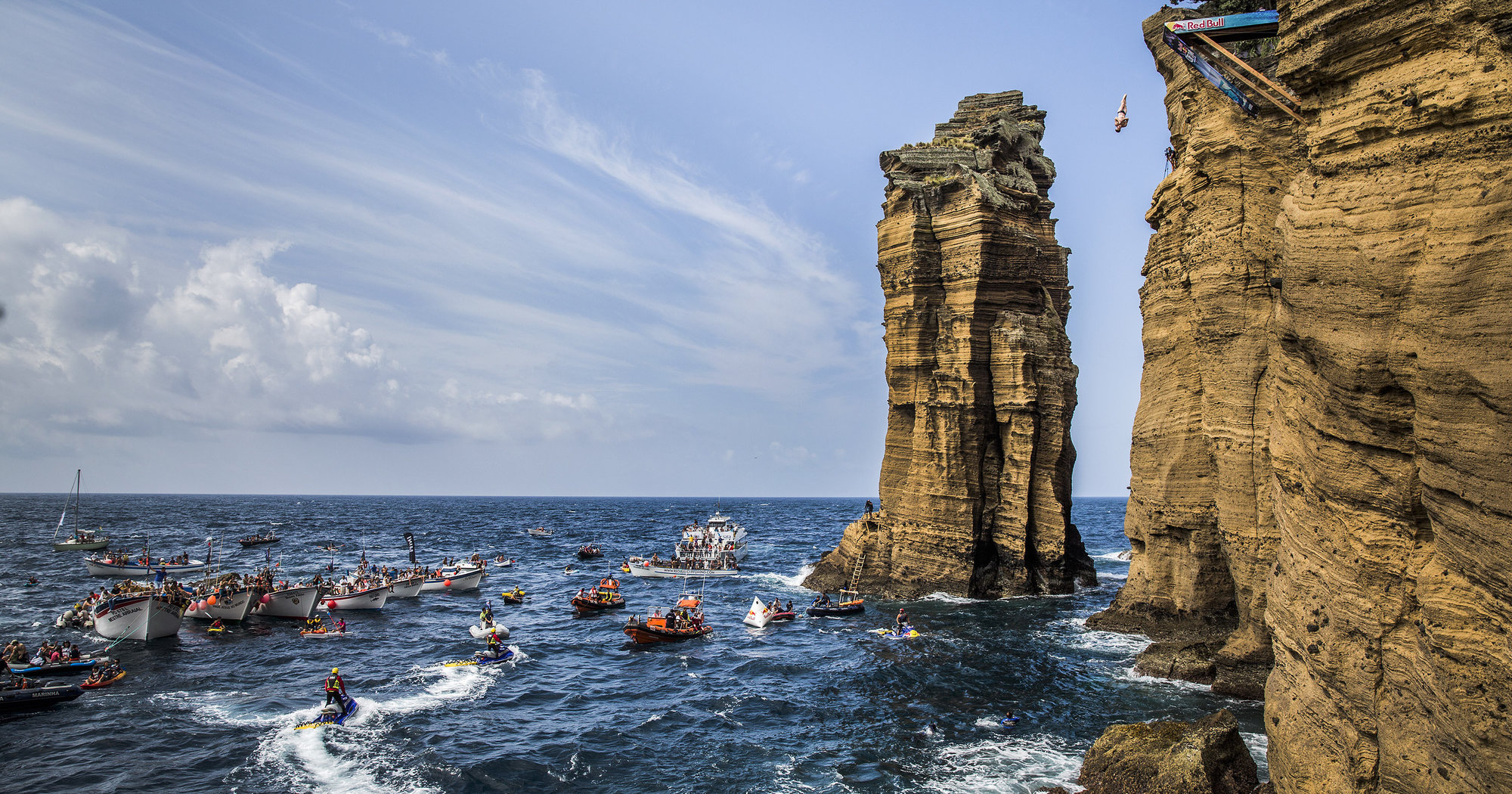 Andy Jones of the USA dives from the 27 metre platform on Islet Vila Franca do Campo during the fifth stop of the Red Bull Cliff Diving World Series, Azores, Portugal, on July 26th 2014.