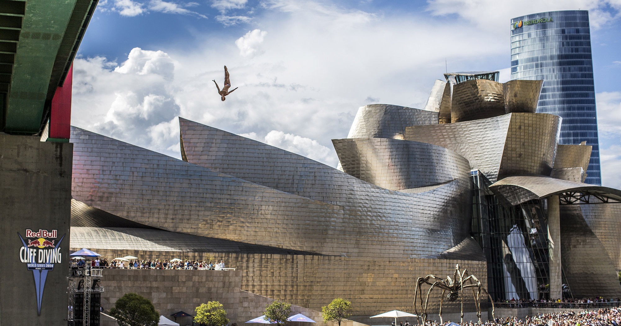 Gary Hunt of the UK dives from the 27 metre platform on La Salves Bridge next to the Guggenheim Museum during the the sixth stop of the Red Bull Cliff Diving World Series, Bilbao, Spain, on September 20th 2014.