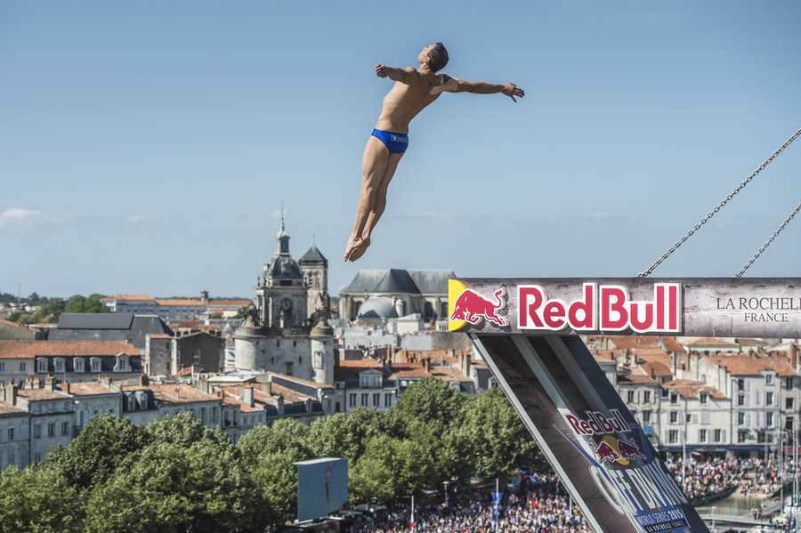 Michal Navratil of the Czech Republic dives from the 27.5 metres platform on the Saint Nicolas Tower during the second stop of the Red Bull Cliff Diving World Series, La Rochelle, France on May 17 2015.